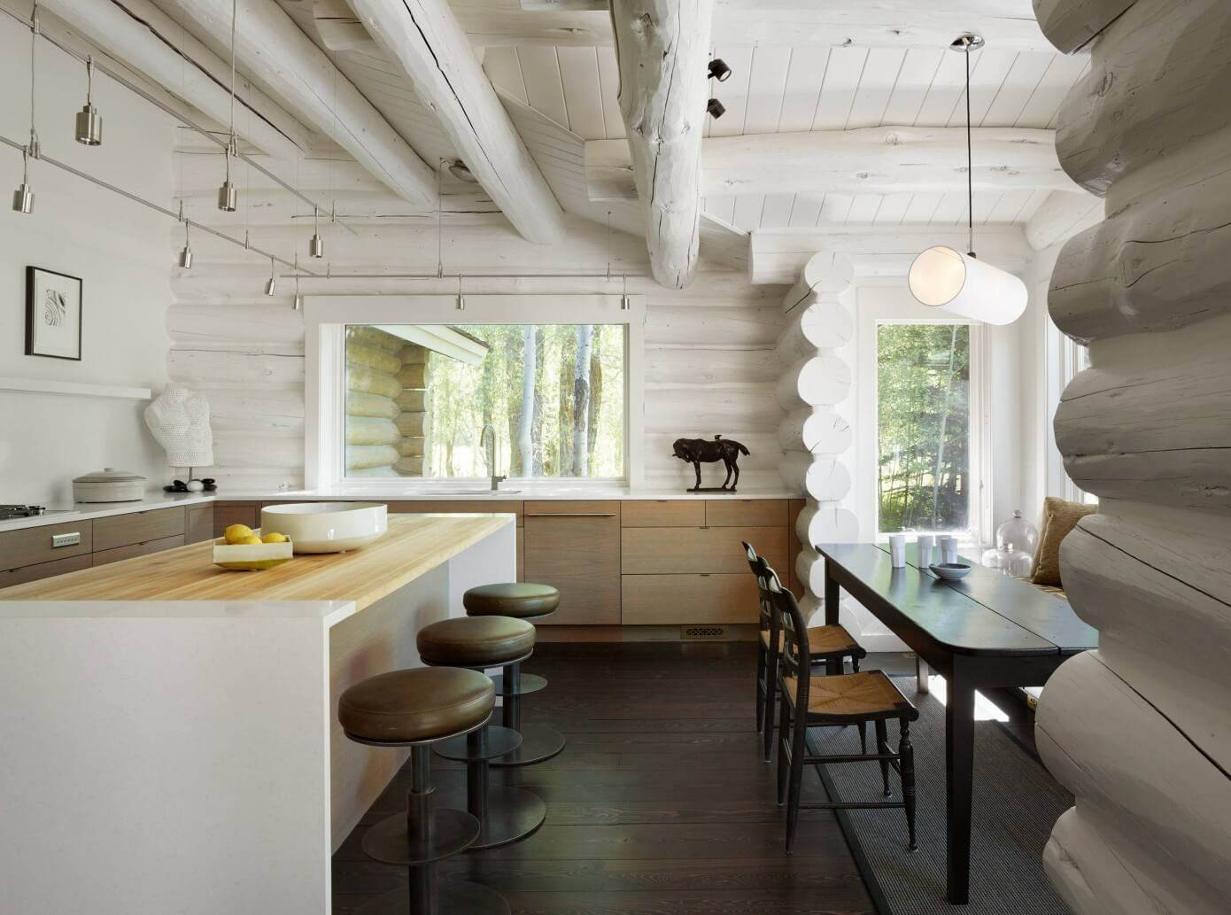 Contemporary design is hard to achive when it comes to log houses but this rustic residence shows it can be ...