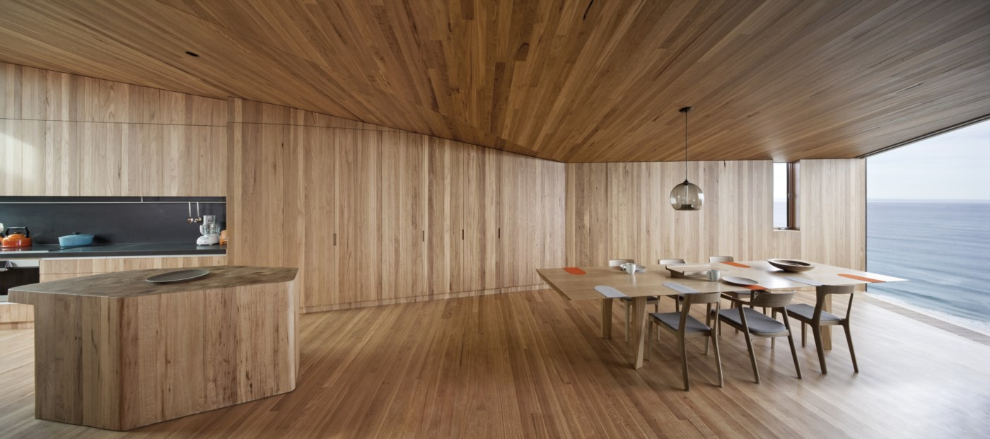 open space wood interior, kitchen dining room and a striking view to the ocean