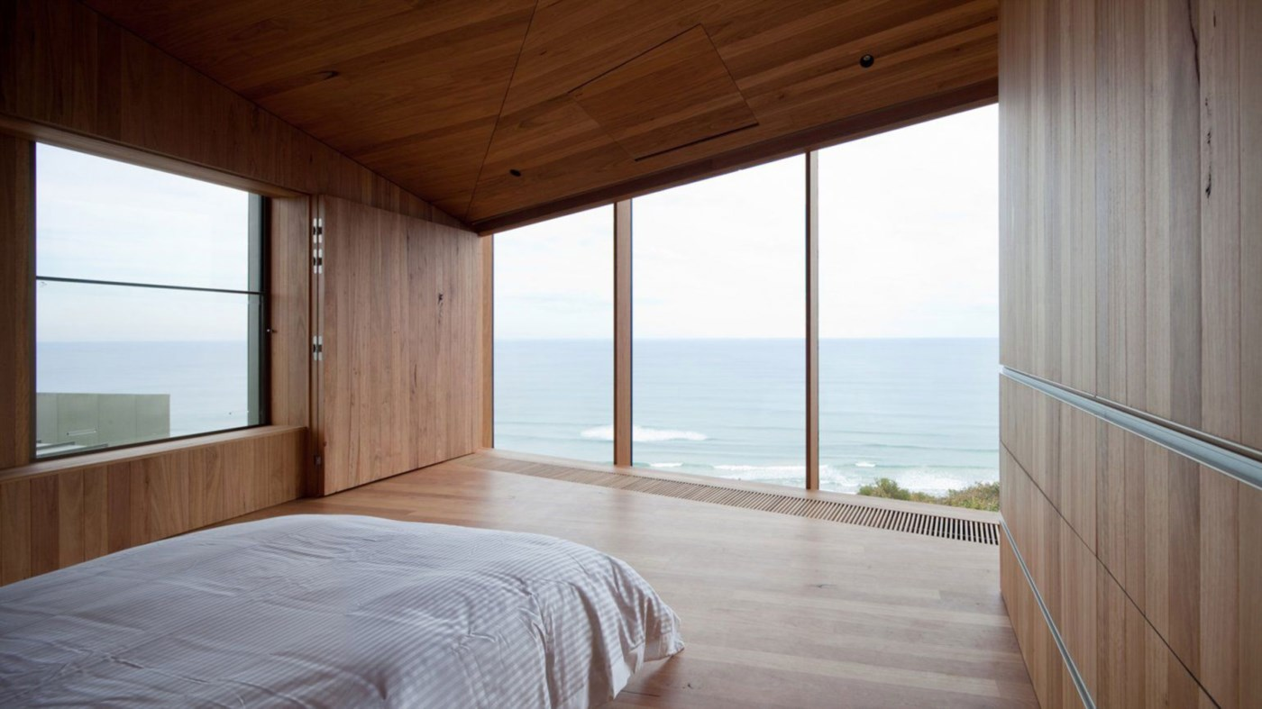 wooden timber interior, modern bedroom with stunning view, wood cladding walls and ceiling