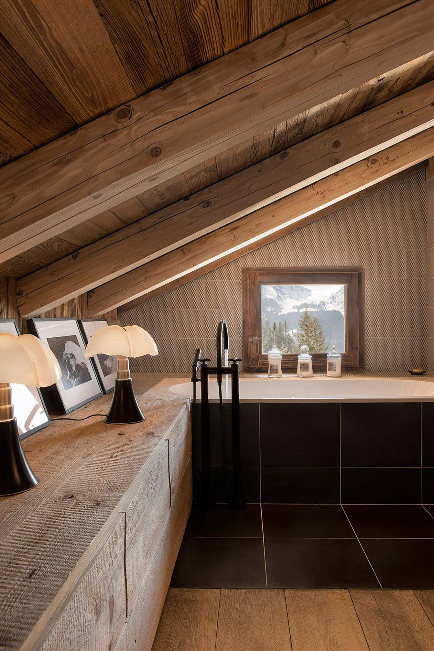 unsanded rough wood drawer and ceiling combine rustic and modern style in this cabin bedroom