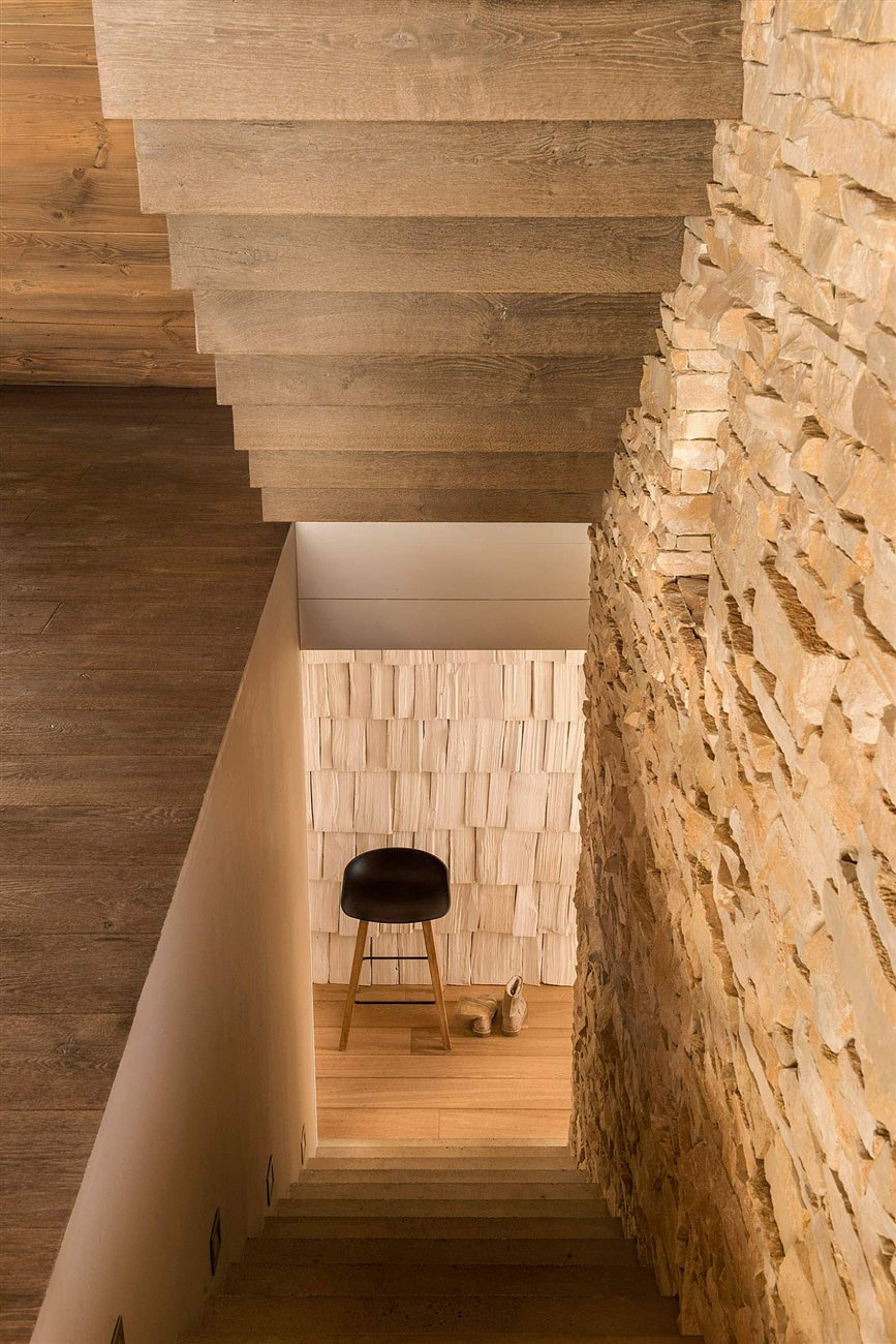 stone walls and wooden interior staircase