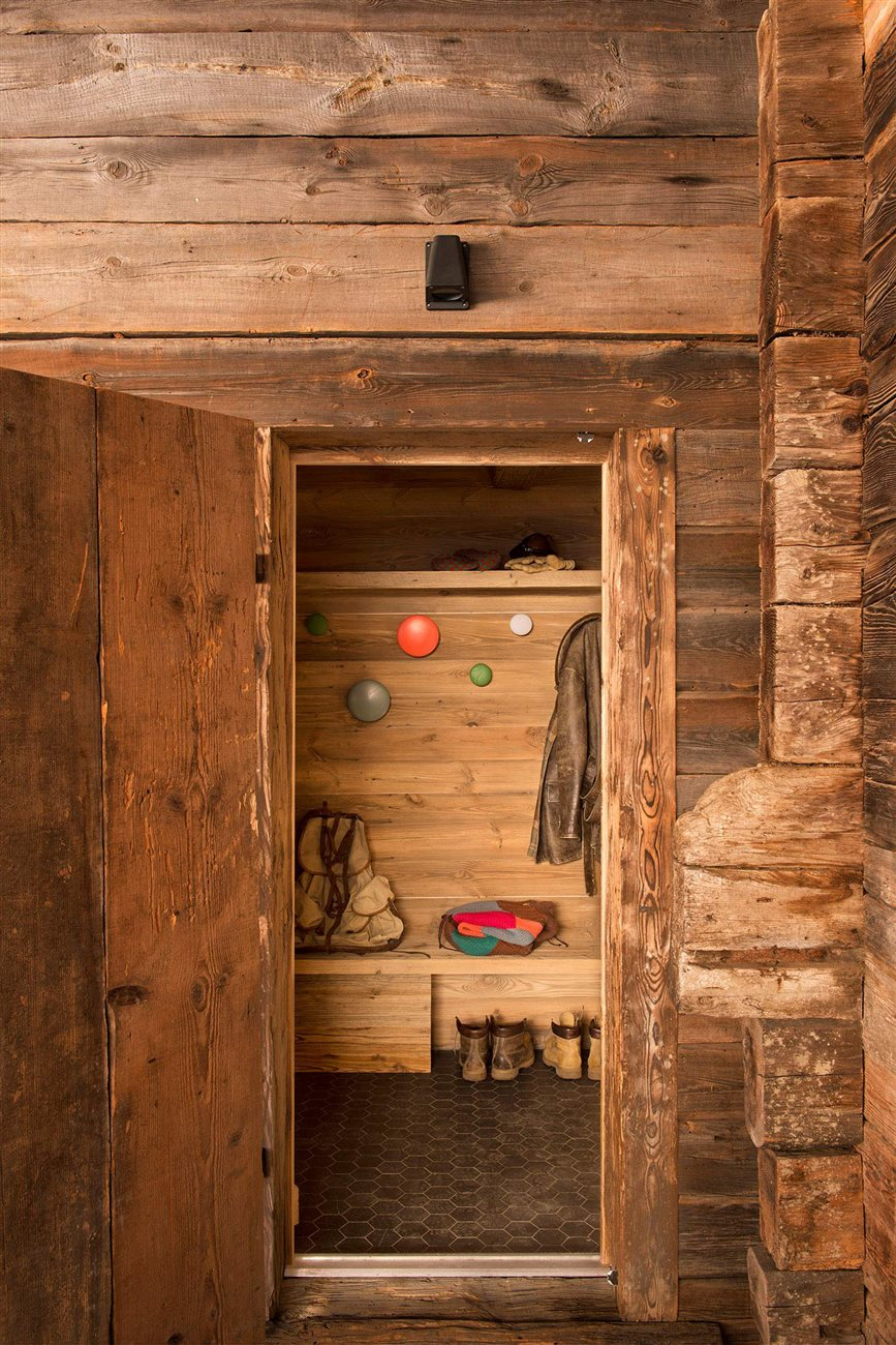 wood cabin entrance with playful wall coat racks