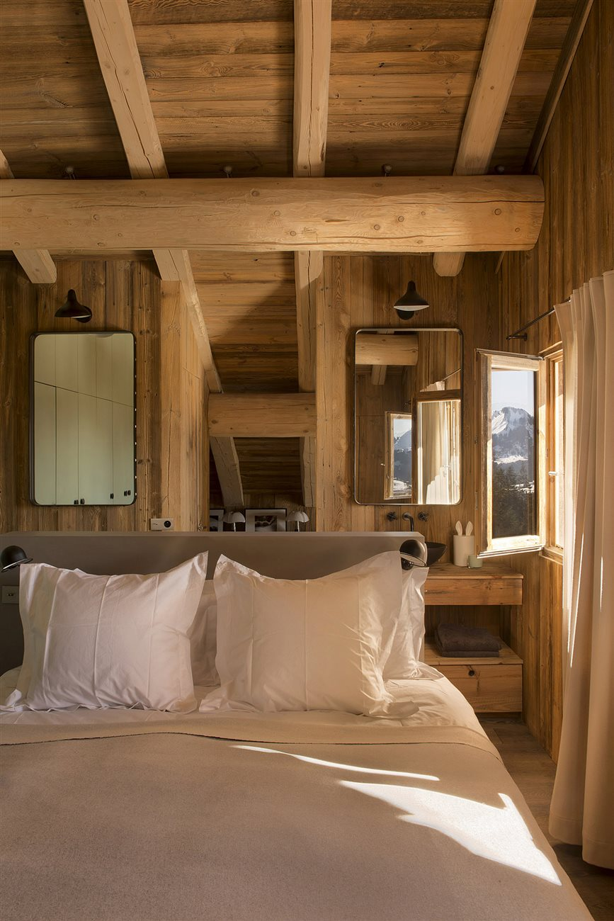 round wooden truss and modern cabin bedroom interior