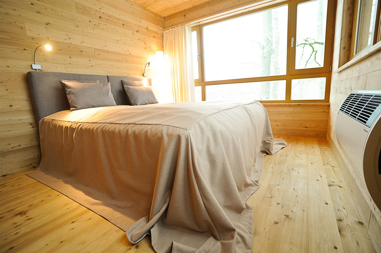 cozy bedroom in wooden treehouse