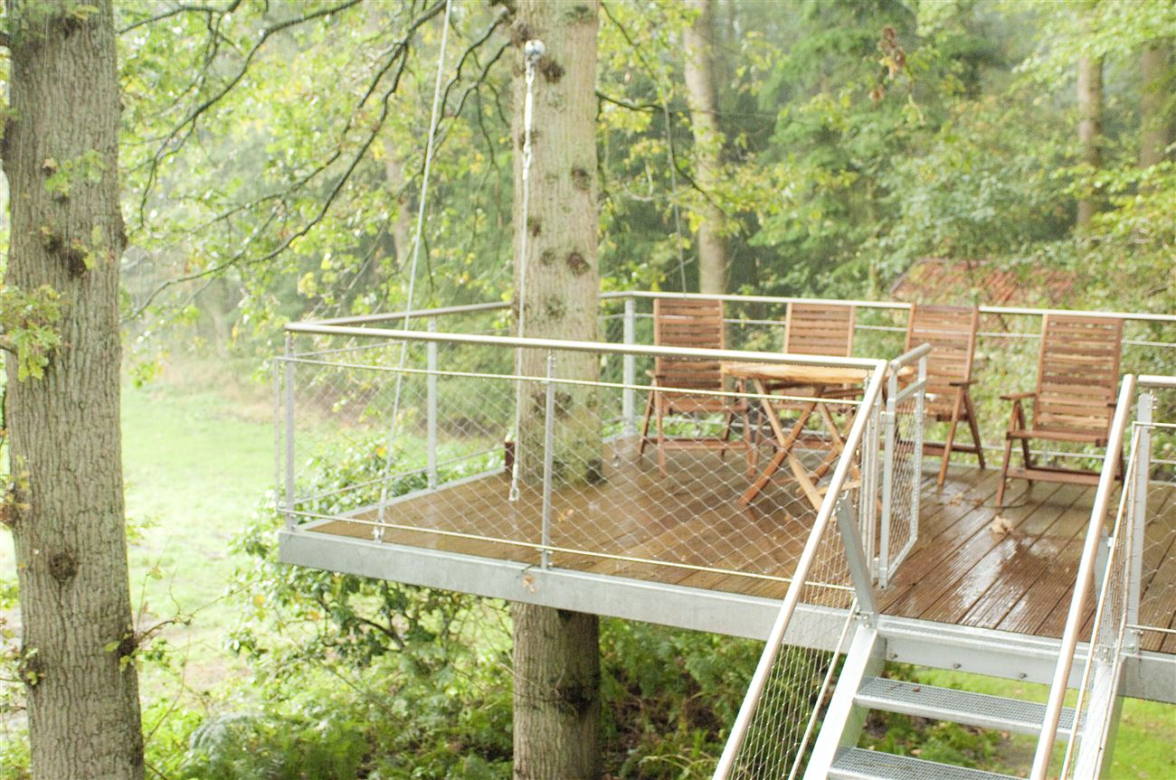 rainy treehouse wooden deck