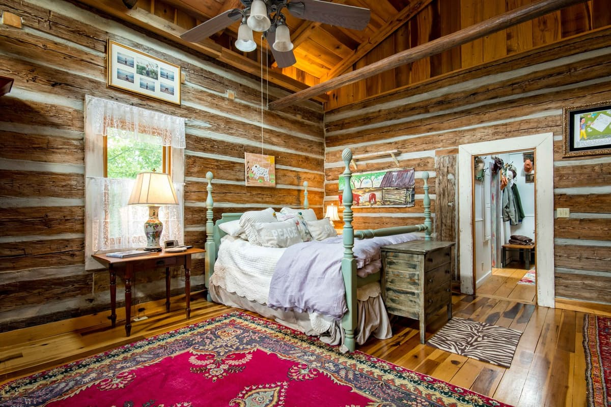 wooden bedroom in log home farmhouse