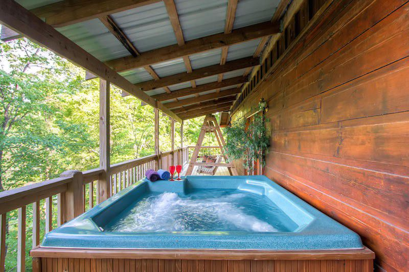log wood house deck with hot tub
