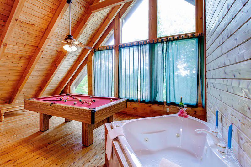 log wood house interior pool table and bath