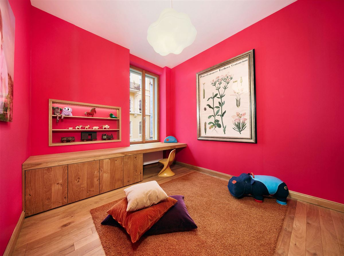 contemporary color and wood interior, wooden drawer and table, hardwood flooring, red pink walls
