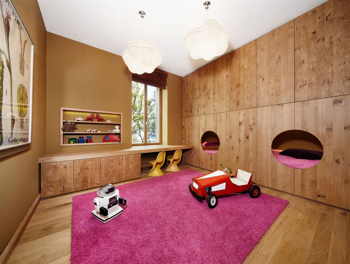 wooden wall closets and children nest beds, hardwood oak flooring and table