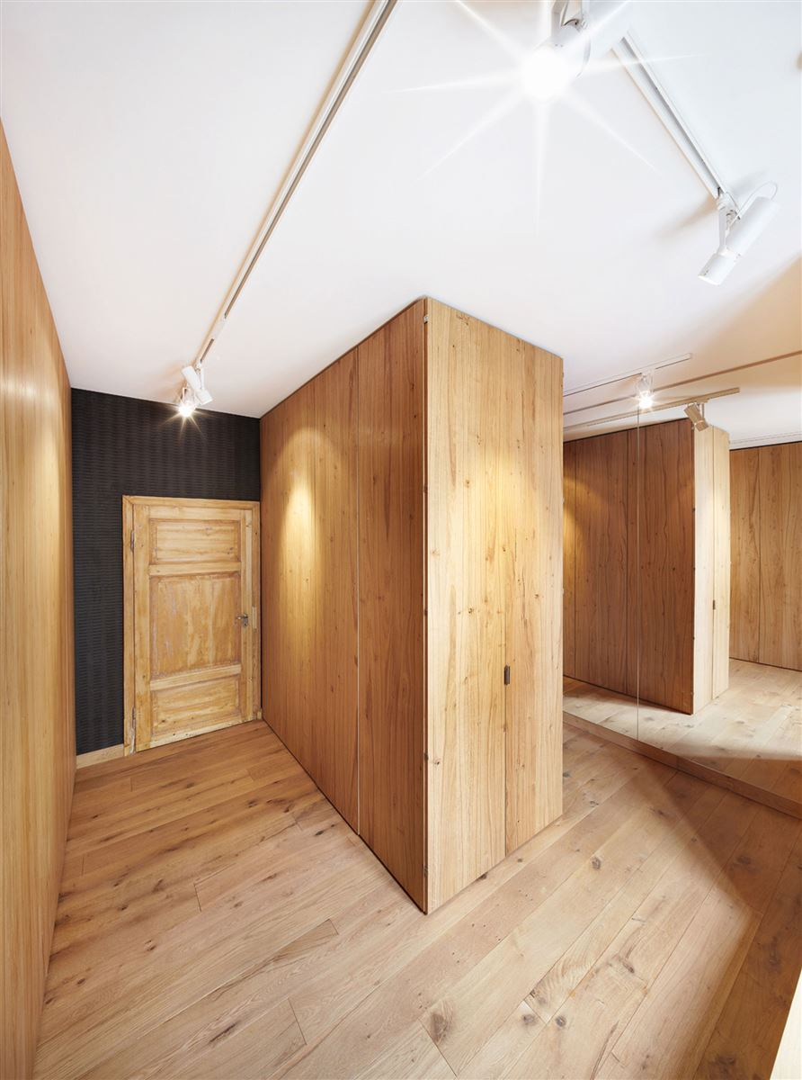 wooden walls and hardwood flooring in this renovated german house
