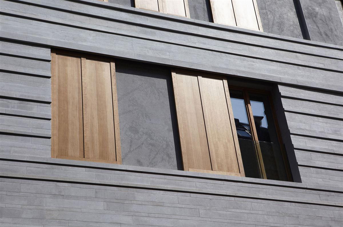 facade modern wood shutters, stone shelves detail