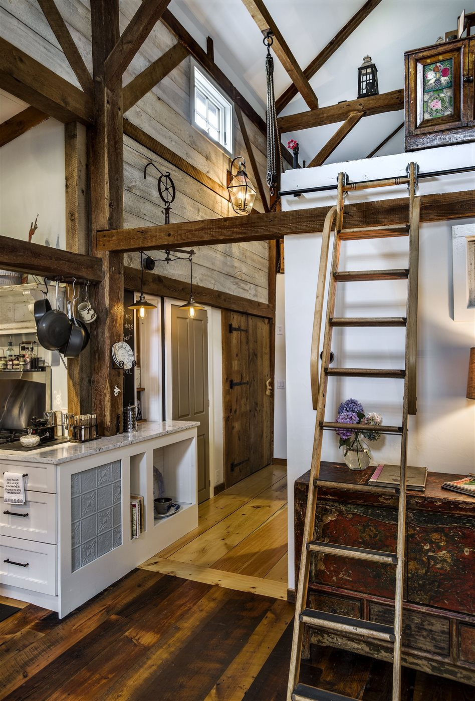 rustic wood ladder in renovated barn house