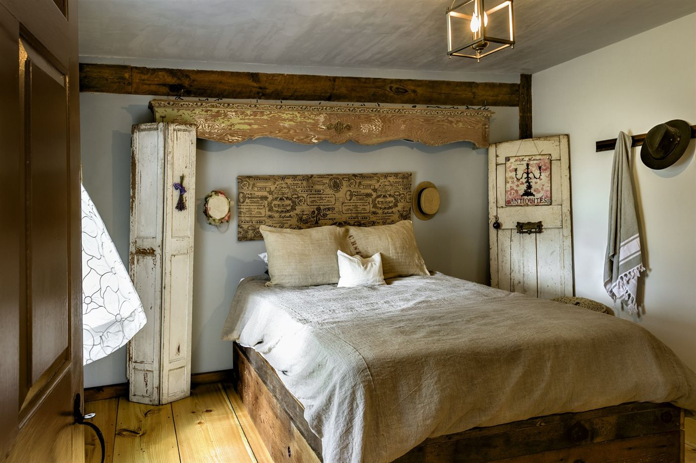 renovated rustic bedroom with washed wood details