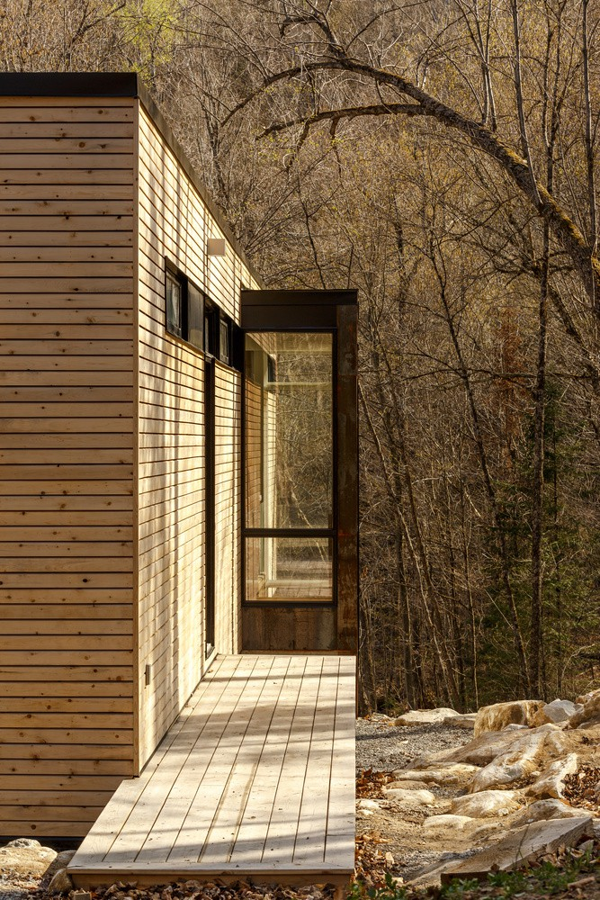 wood cladding facade and exterior flooring lake forest house