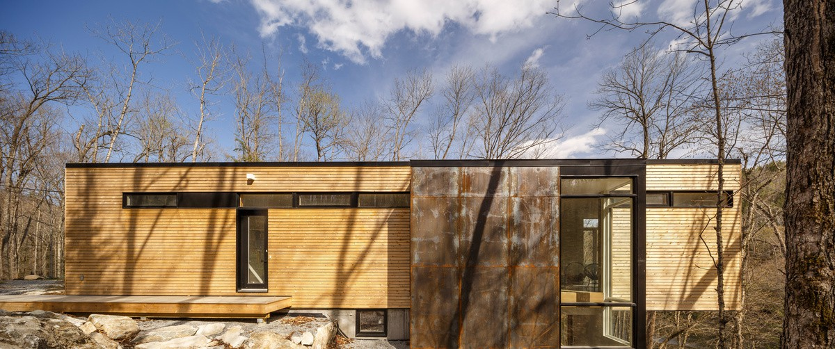 wood and metal facade cladding, modern forest cabin