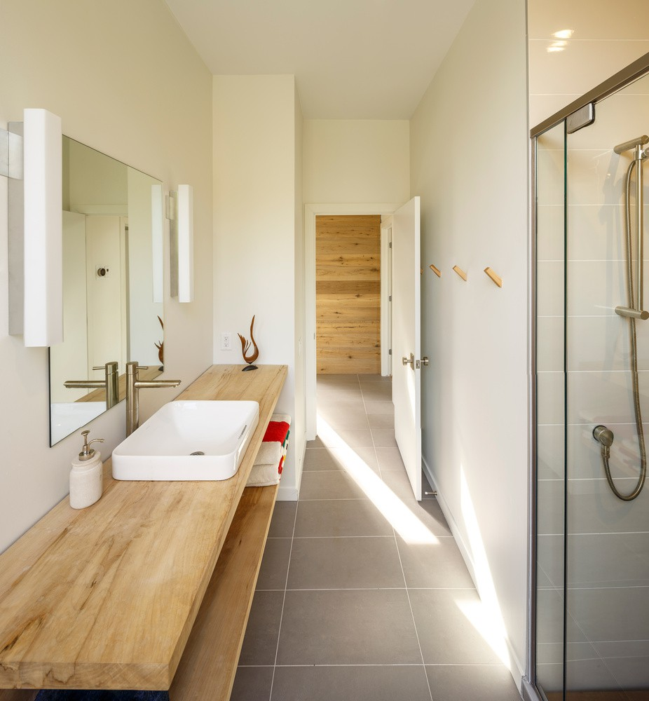 wood bathroom furniture and bright modern walls and ceiling