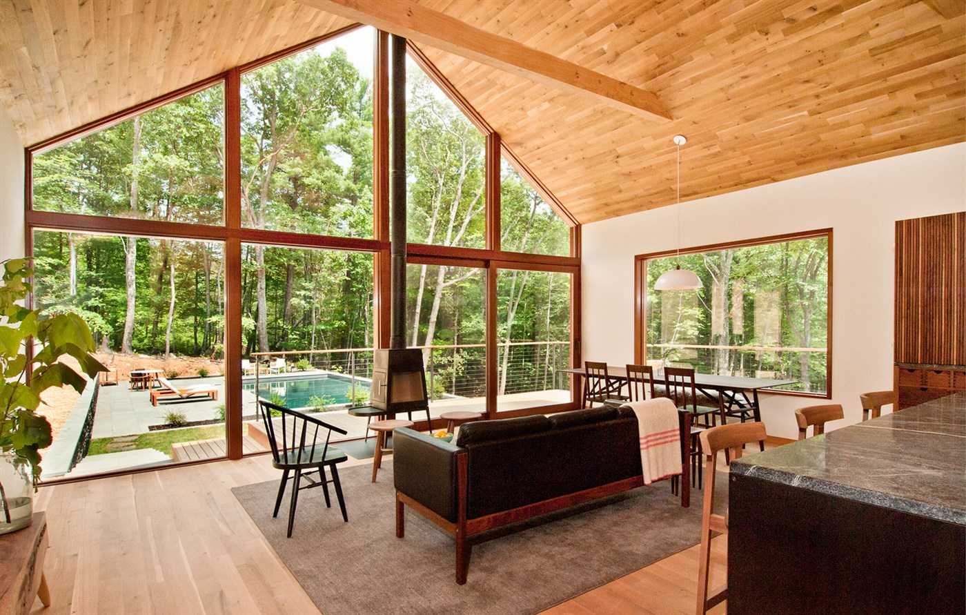wood floor and ceiling with beam, wooden chair, table and sofa, living room design ideas