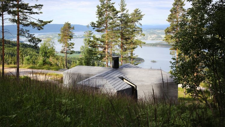 The cabin is supported by steel rods drilled directly into the rock, supplemented with a small concrete foundation under the ...