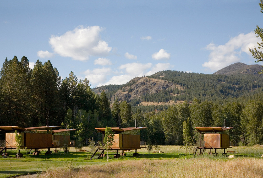 Rolling huts sit lightly on the site, a flood plain meadow in an alpine river valley. The owner purchased the ...