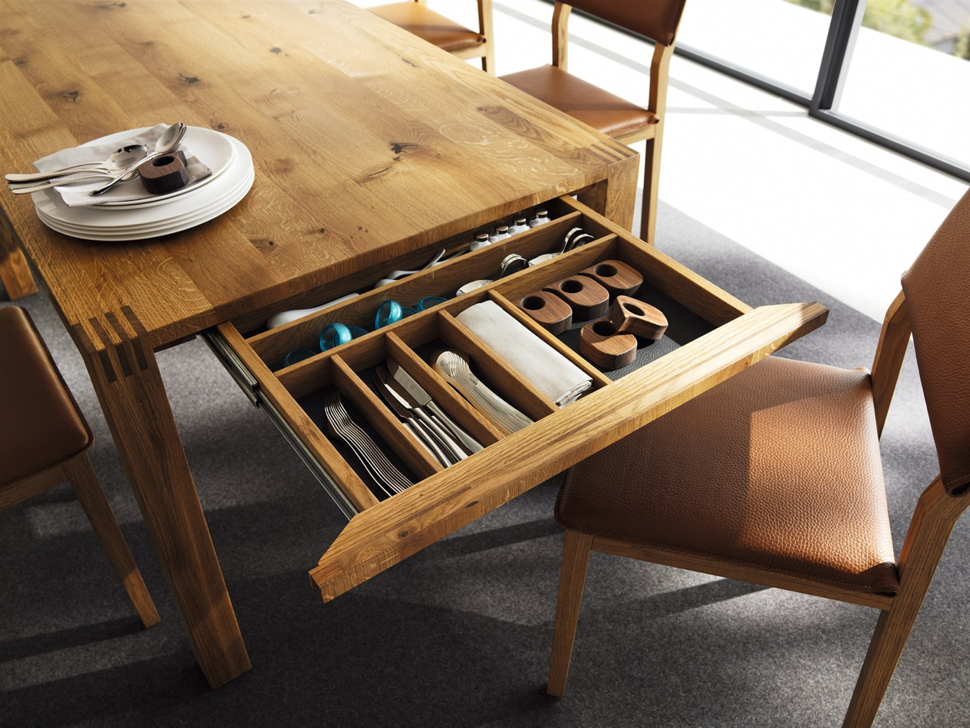 A dining table is more than just a place where you eat. It is the heart of the home where ...
