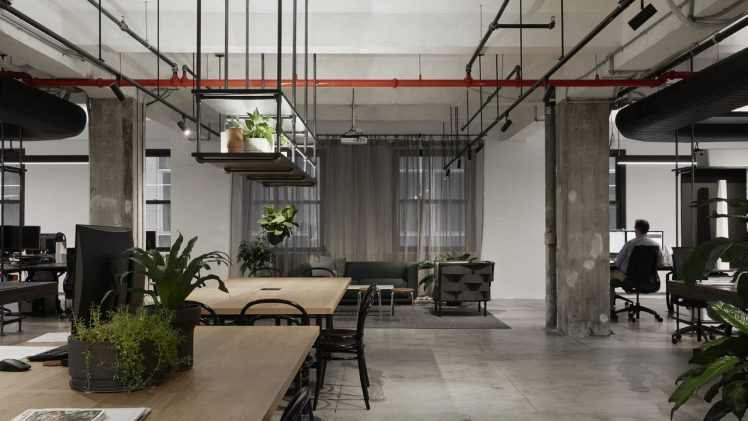 The newly-renovated New York office of architectural firm Woods Bagot is reflective of one thing, the city's gritty personality. Black ...