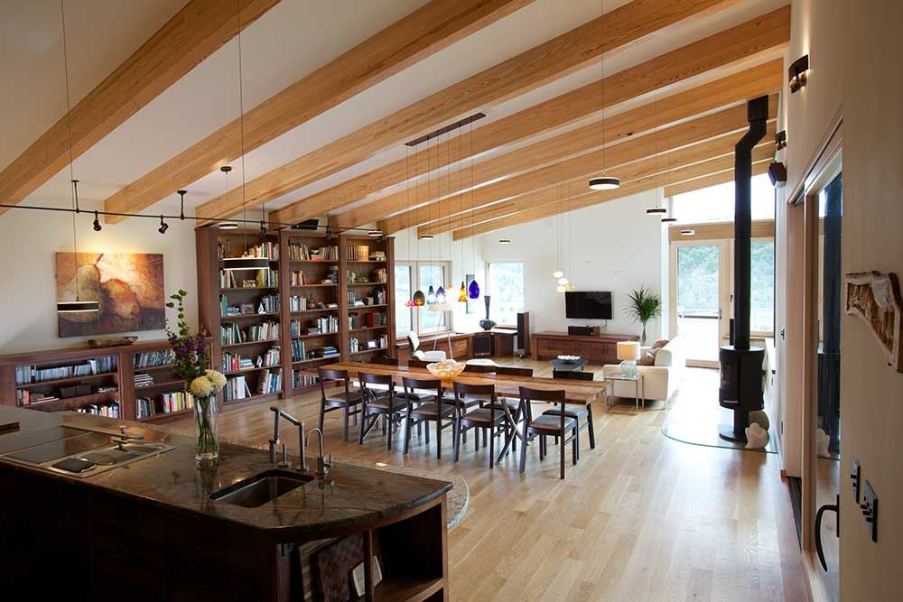 wood ceiling and floor, cozy wood table, fireplace