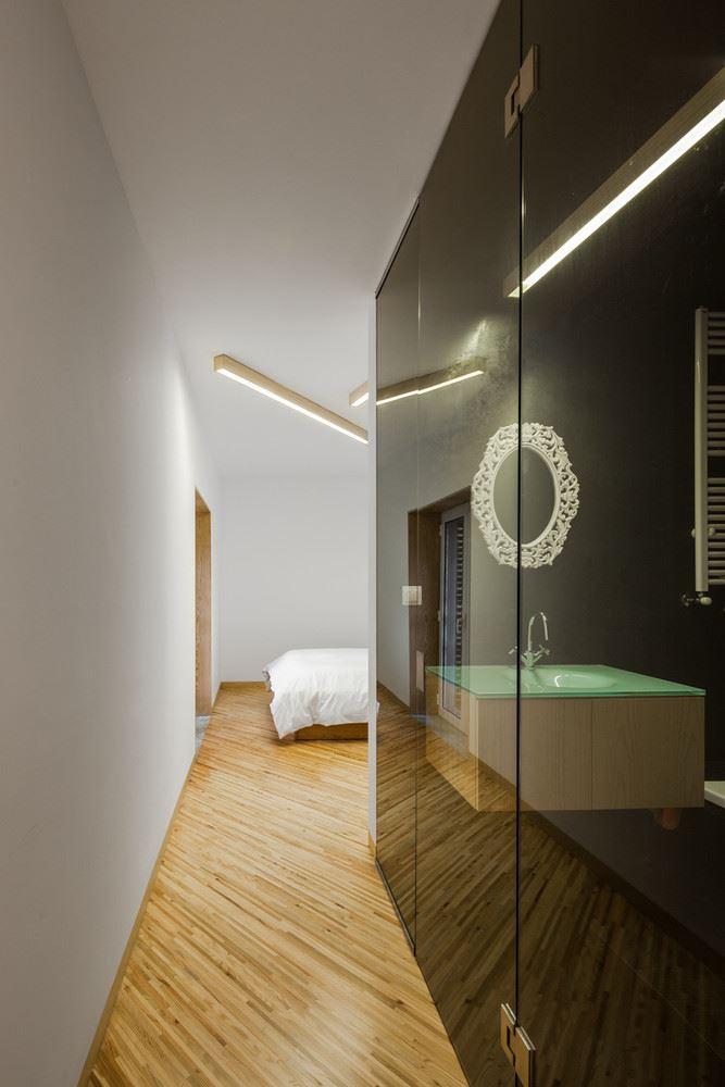 bedroom and bathroom, wood floor