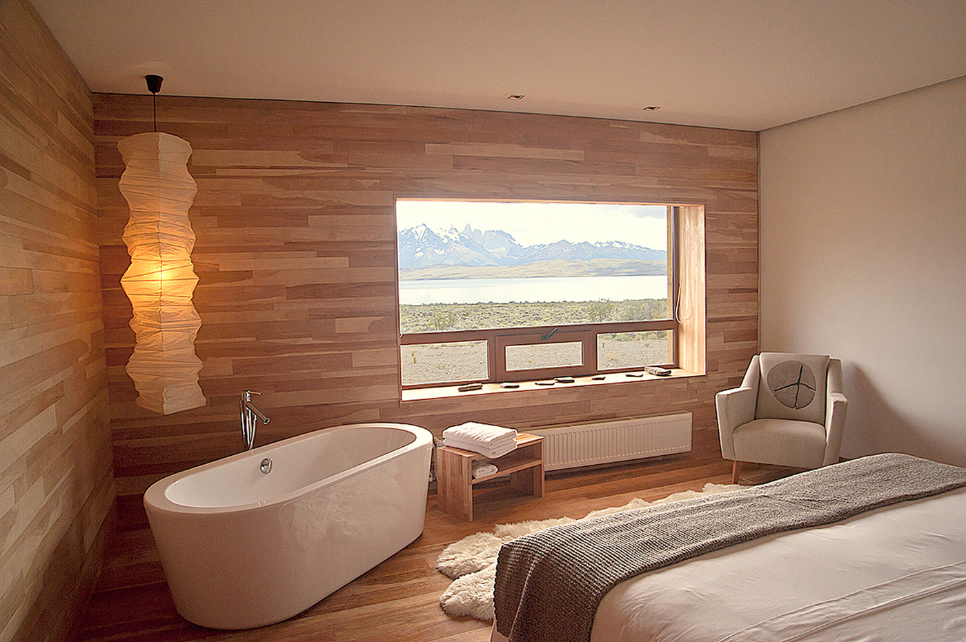 Wood wall and floor, sleeping room with bathtub