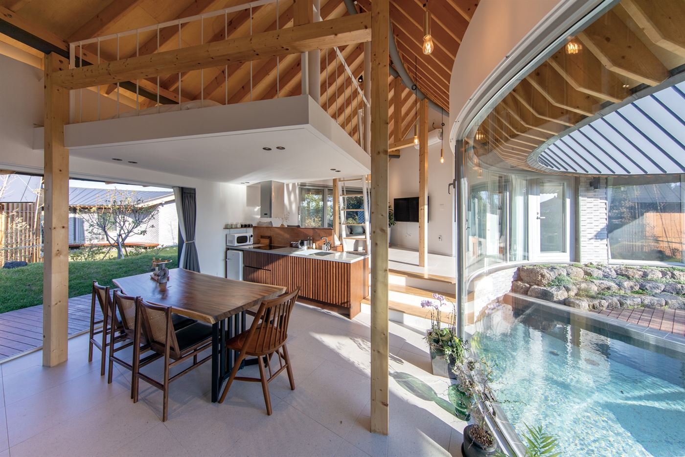 wood beam ceiling and furniture, kitchen with a pool