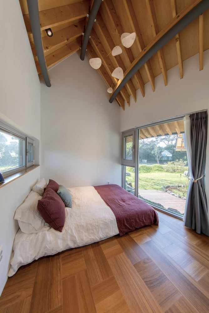 wood beam ceiling and floor, bedroom